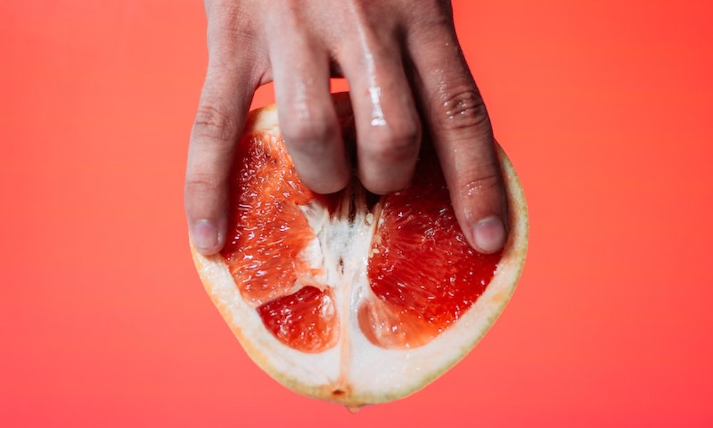 Fingers in a grapefruit representing an orgasm